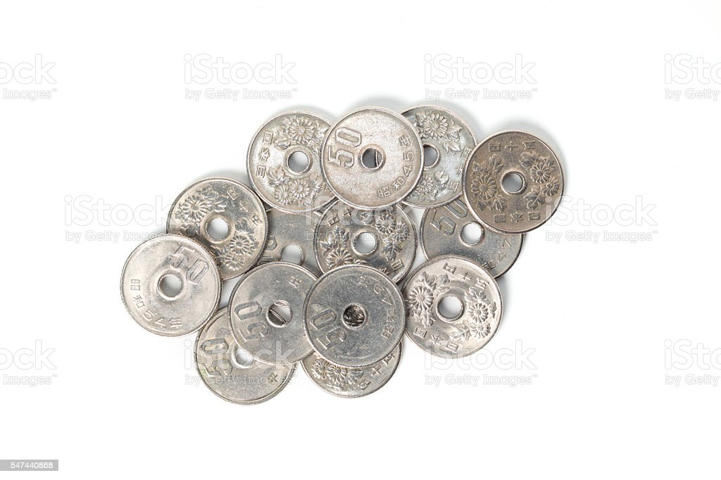 Pile of 50 yen coins japanese money on white background. stock photo