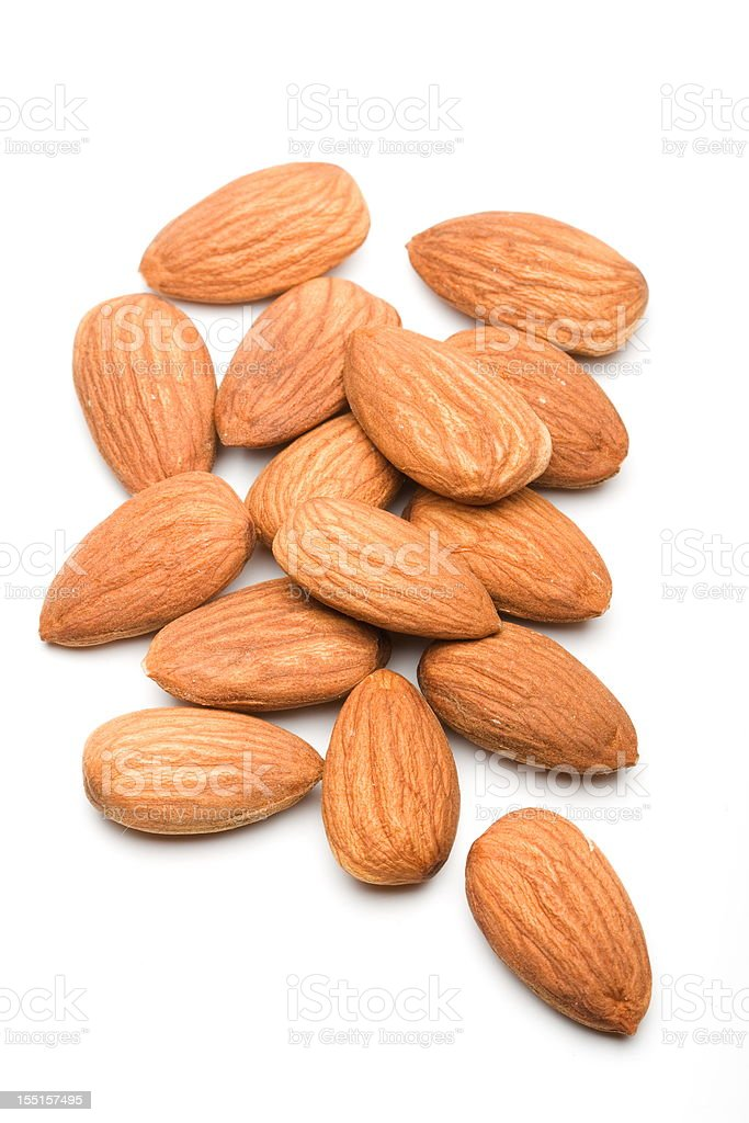 Pile of almonds on the table of a white background stock photo