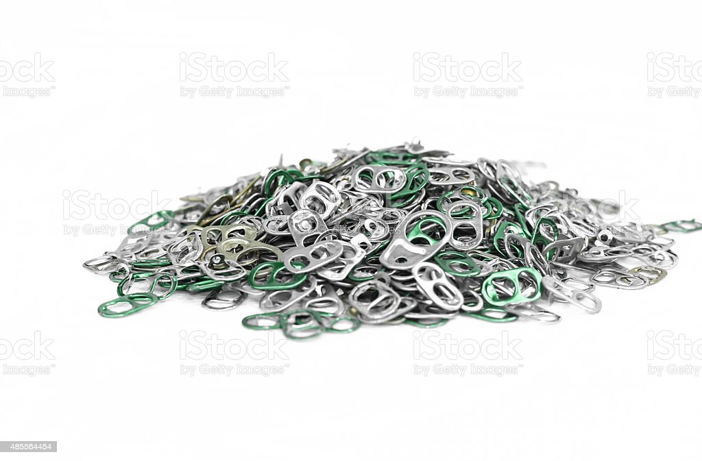 Pile of Aluminum tops cap can stock photo