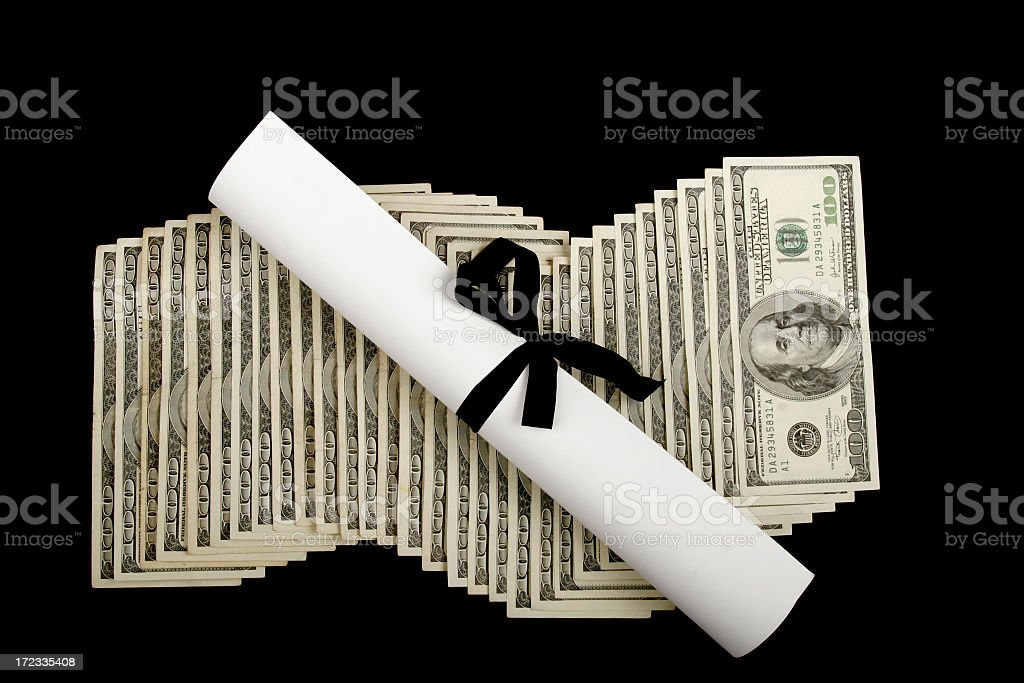 Pile of American cash and a rolled up paper stock photo