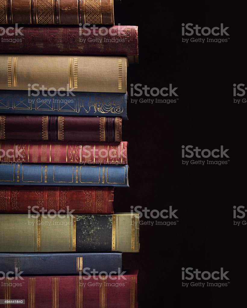 Pile of ancient books stock photo
