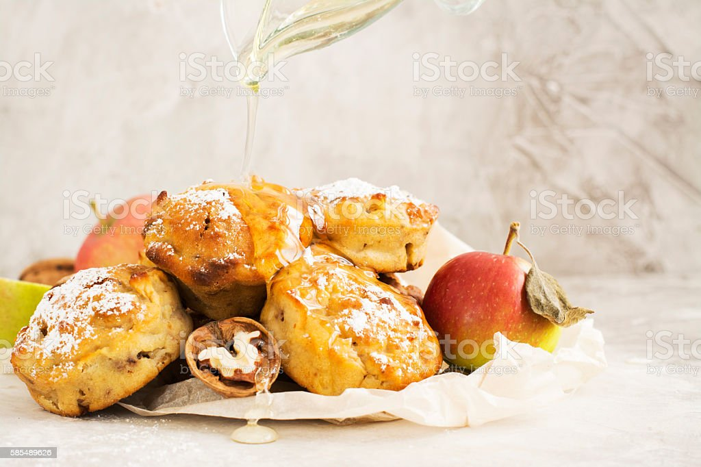 Pile of apple and walnut cupcakes over stone background stock photo