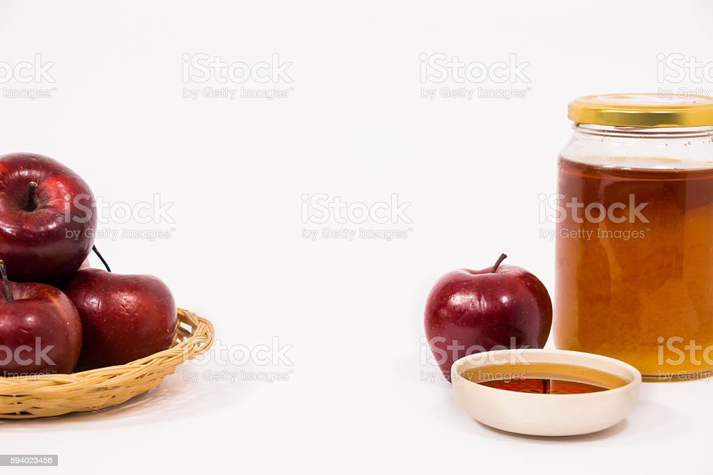 Pile of apples  and jar of honey bowl of honey stock photo