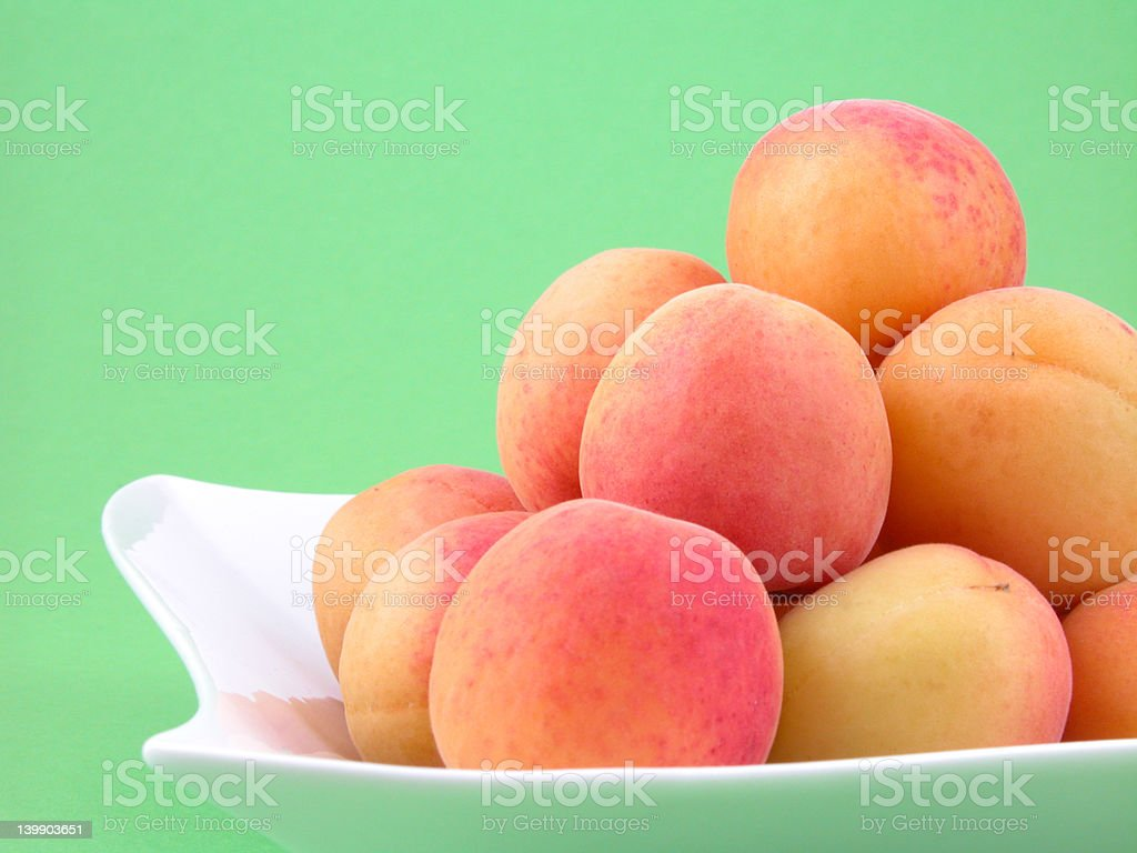 pile of apricots stock photo