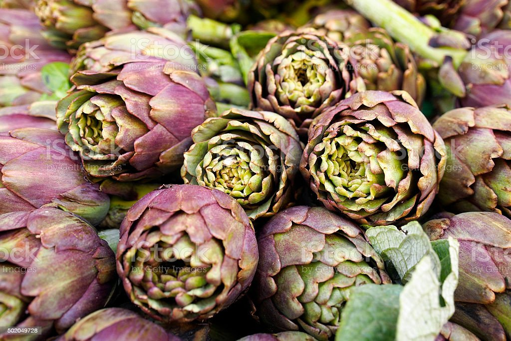 Pile of artichokes stock photo