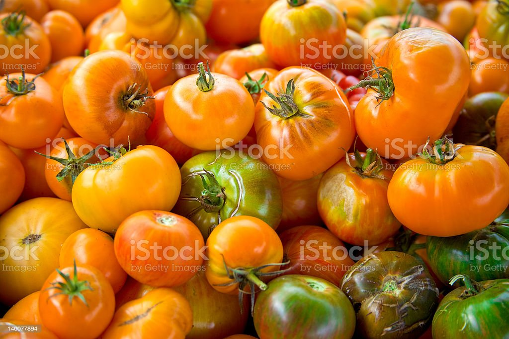 Pile of Assorted Heirloom Tomatoes royalty-free stock photo