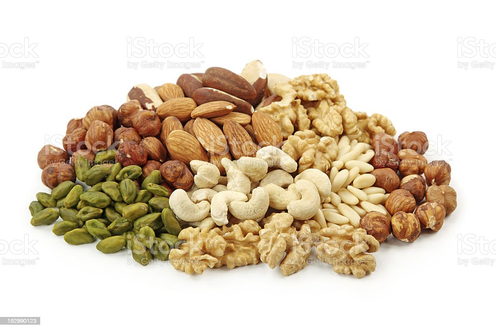 Pile of assorted nuts on white background stock photo