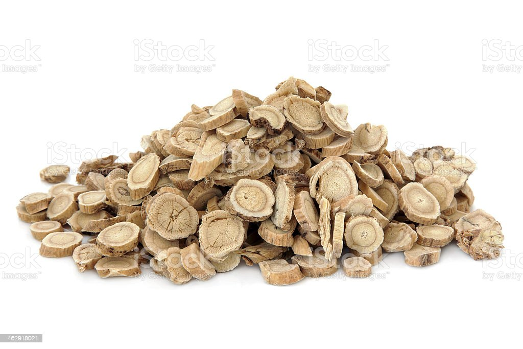 A pile of Astragalus root on white background stock photo