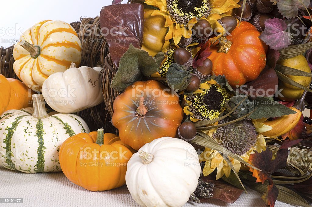 A pile of autumn ornaments containing pumpkins and leaves. royalty-free stock photo