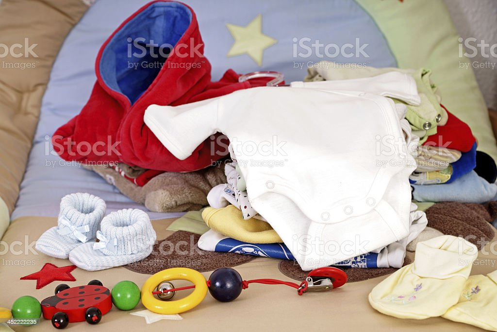 A pile of baby accessories and clothing stock photo