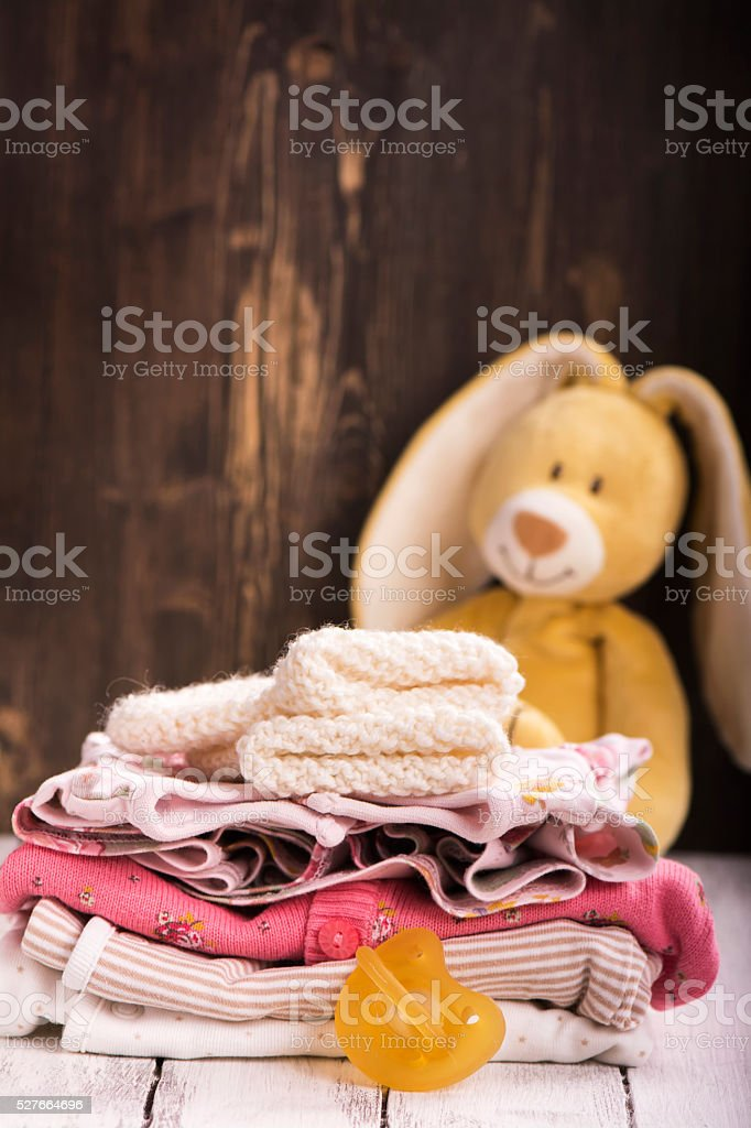 Pile of baby clothes for newborn stock photo