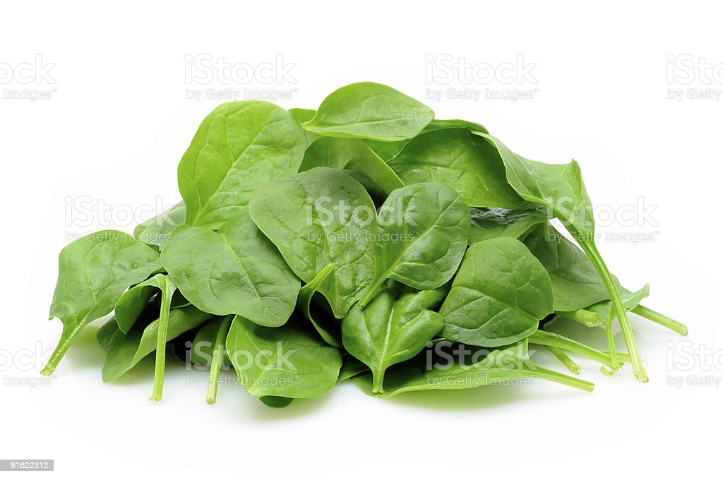 Pile of baby spinach leaves on white stock photo