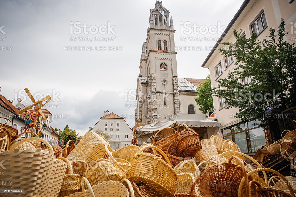 Pile of baskets in front of church stock photo