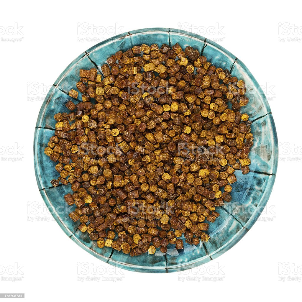Pile of bee bread in a plate royalty-free stock photo