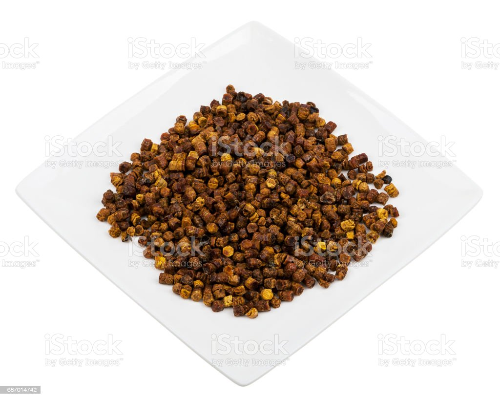 Pile of bee bread in a plate stock photo