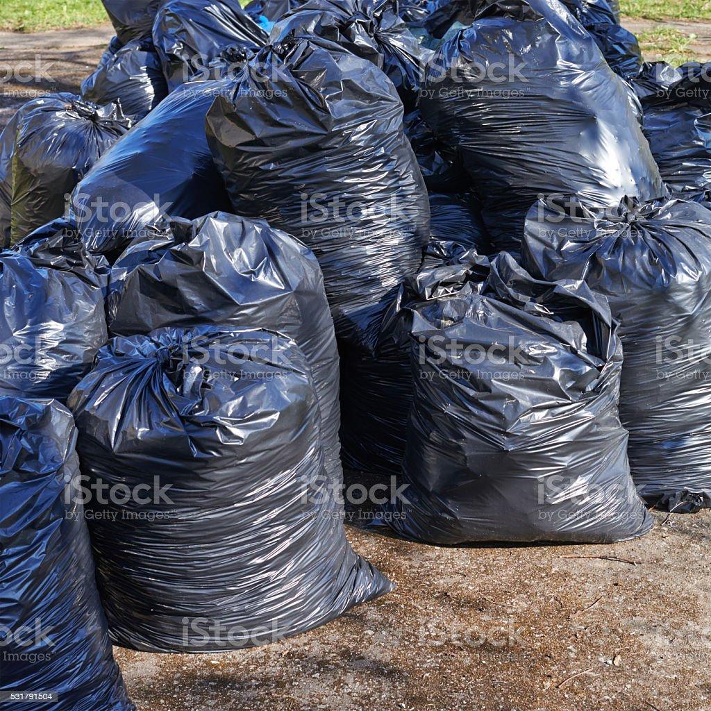 Pile of black garbage bags stock photo