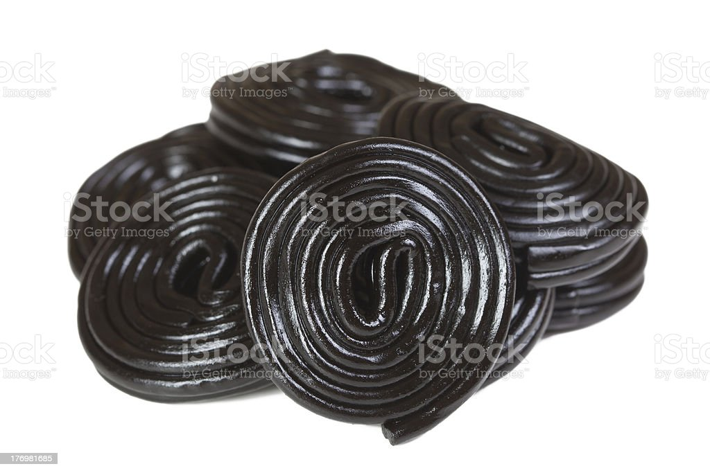 Pile of black licorice candy spirals stock photo