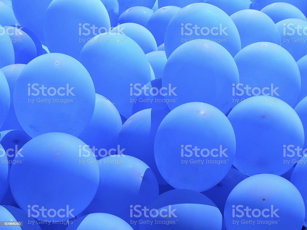 Pile of blue balloons in sunlight stock photo