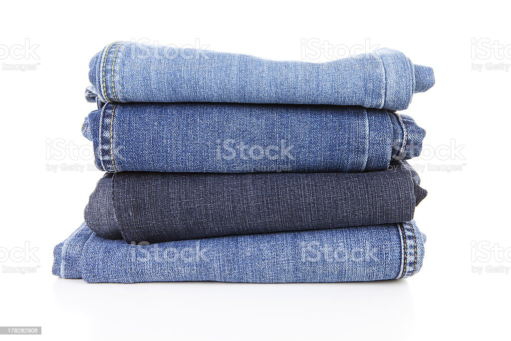 Pile of blue jeans stock photo