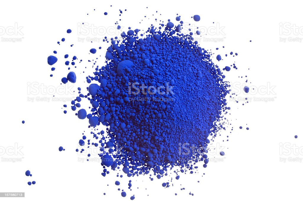 Pile of blue pigment powder on white close-up stock photo