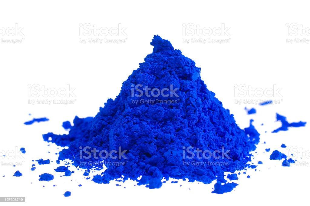 Pile of blue pigment powder on white stock photo