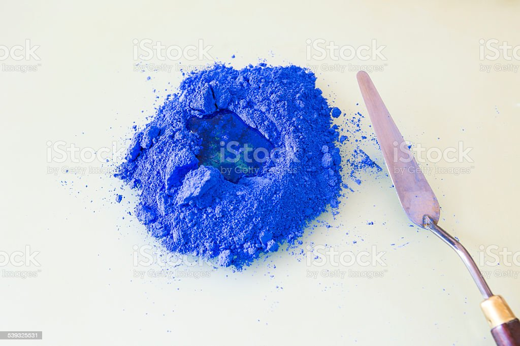 Pile of blue pigment with linseed oil to make oil paint stock photo