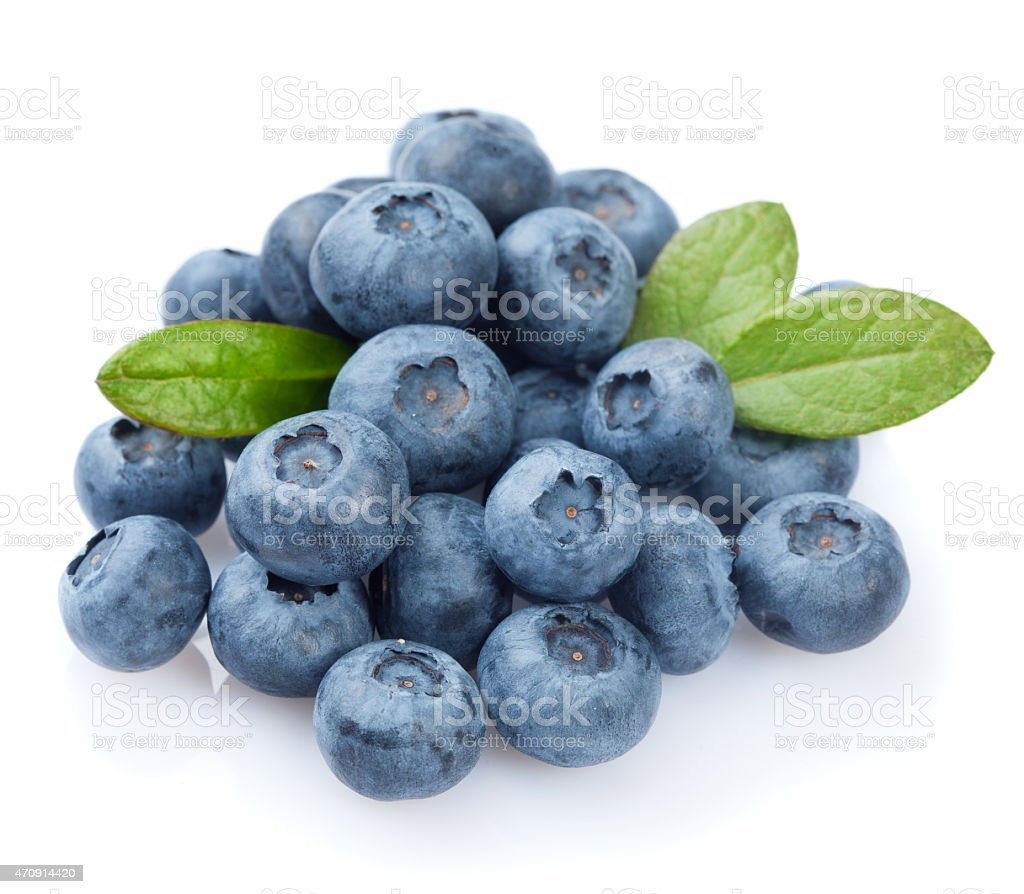 Pile of blueberries with leaves stock photo
