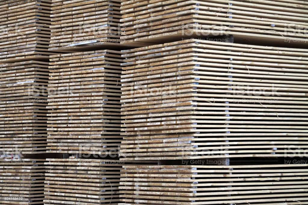 Pile of boards in a sawmill stock photo