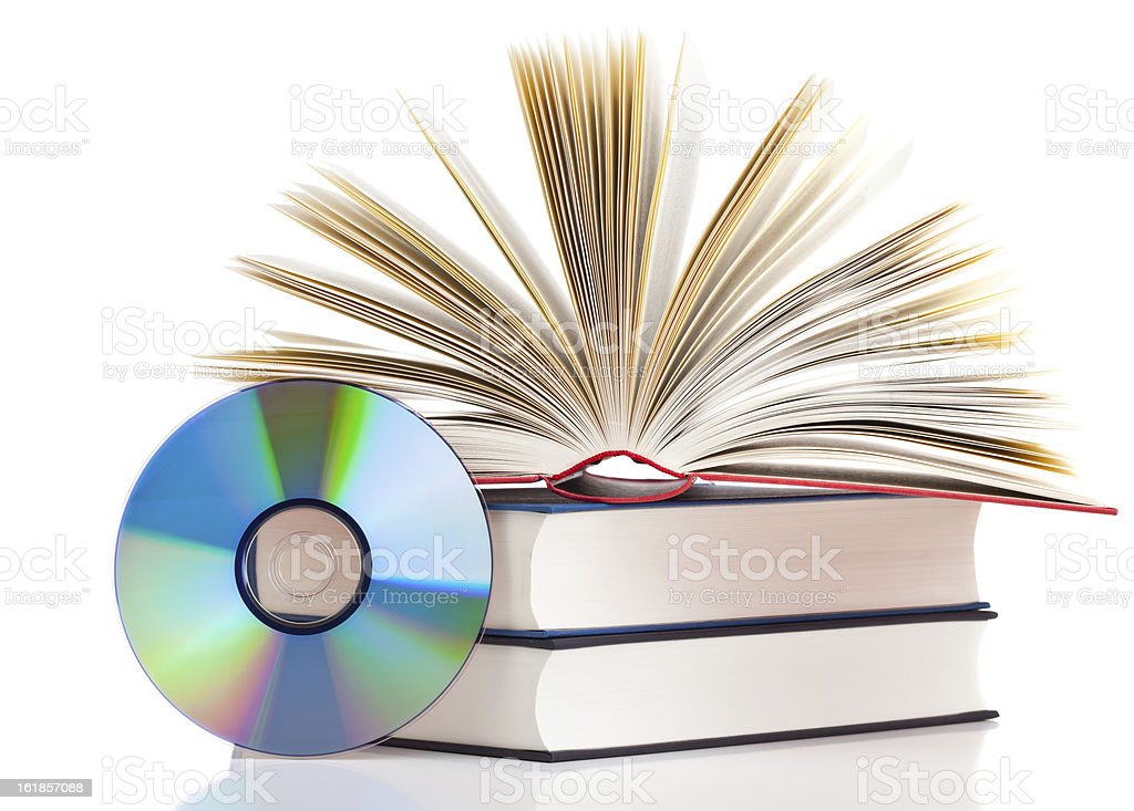 Pile of books and a CD on a white surface stock photo