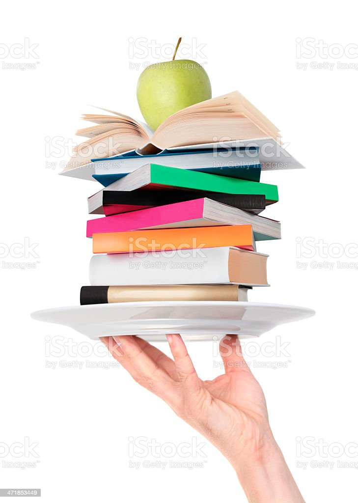 Pile of books and green apple on the plate royalty-free stock photo