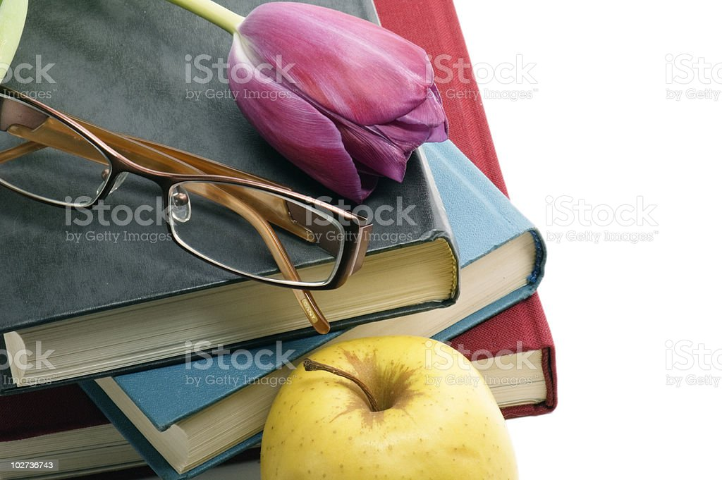 Pile of books, glasses and Tulip stock photo