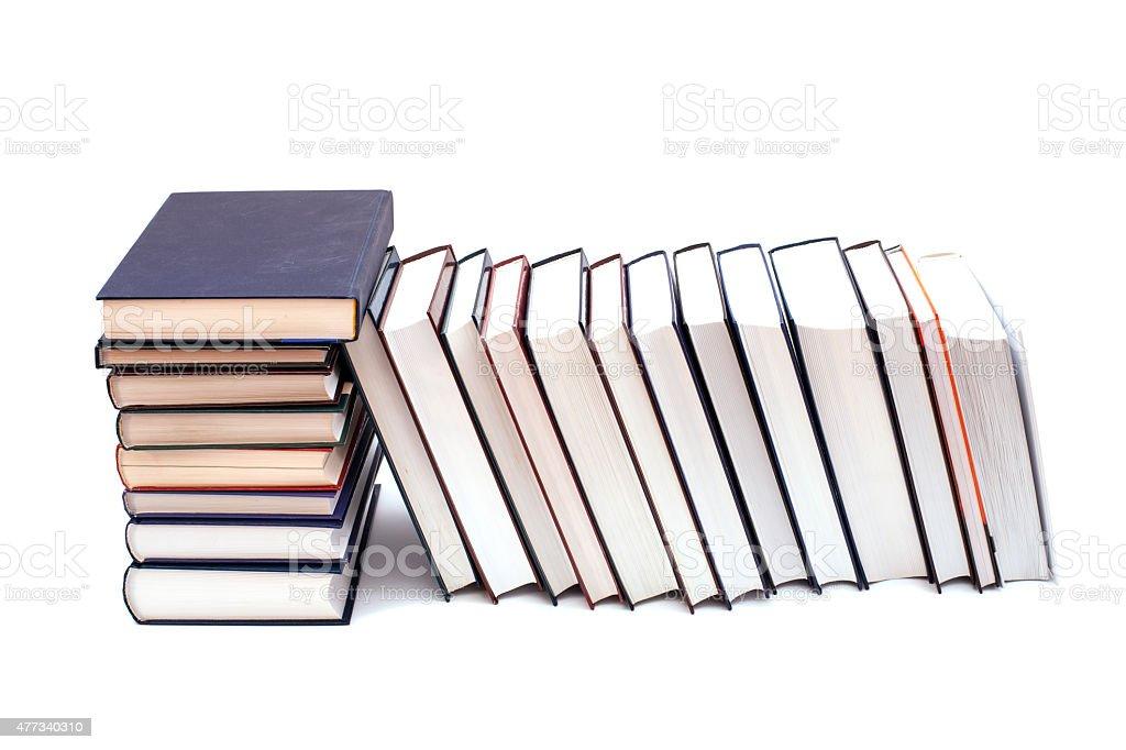 Pile of books isolated on white background stock photo