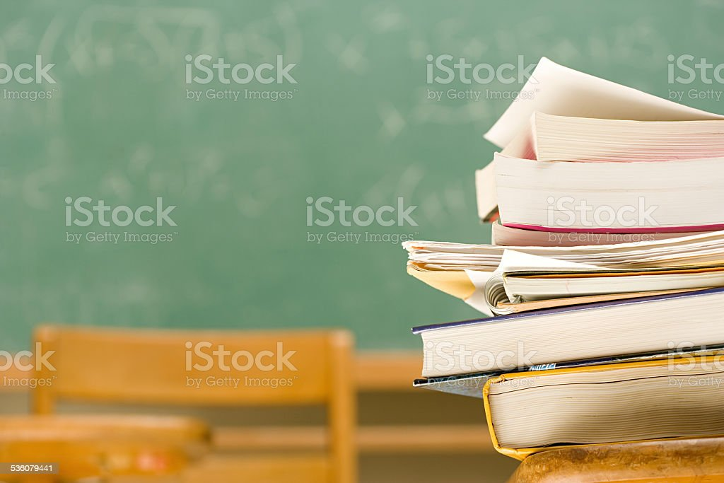 Pile of books on a desk stock photo