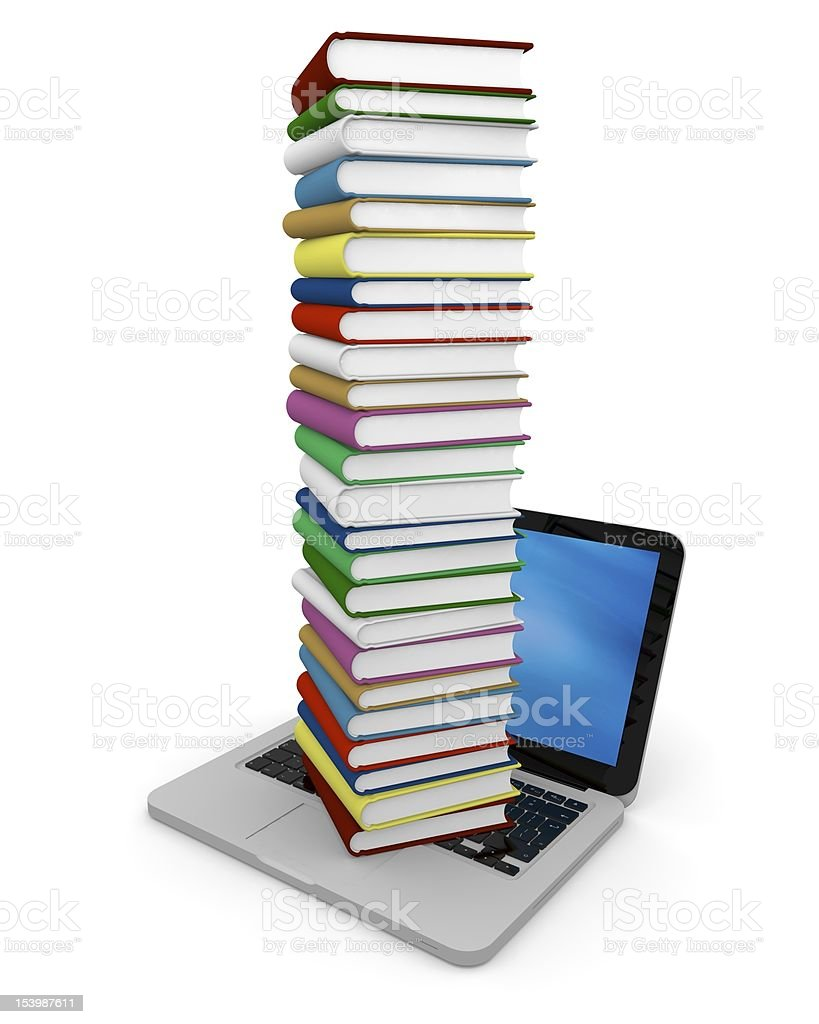 Pile of books on laptop stock photo