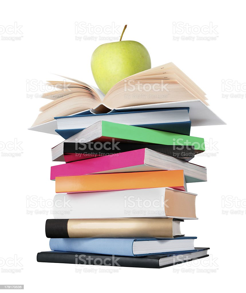 Pile of books with green apple on the top royalty-free stock photo
