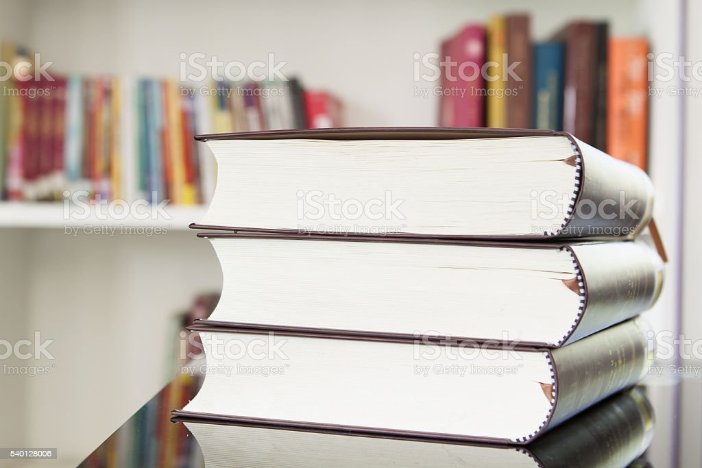 pile of books with library. stock photo