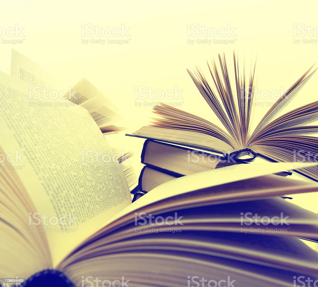 Pile of books with pages fanned out royalty-free stock photo
