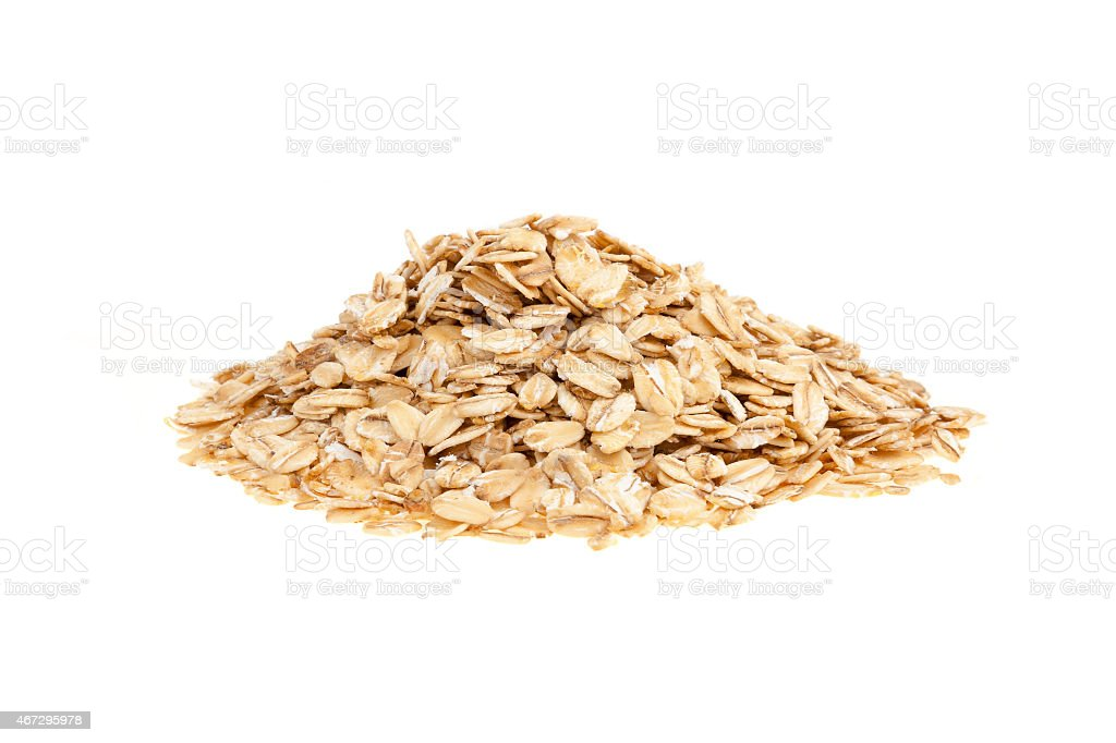 Pile of bran oat flakes with white background stock photo