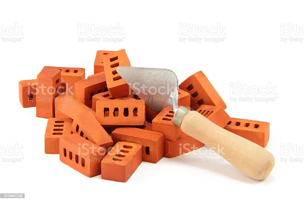 pile of bricks and trowel stock photo
