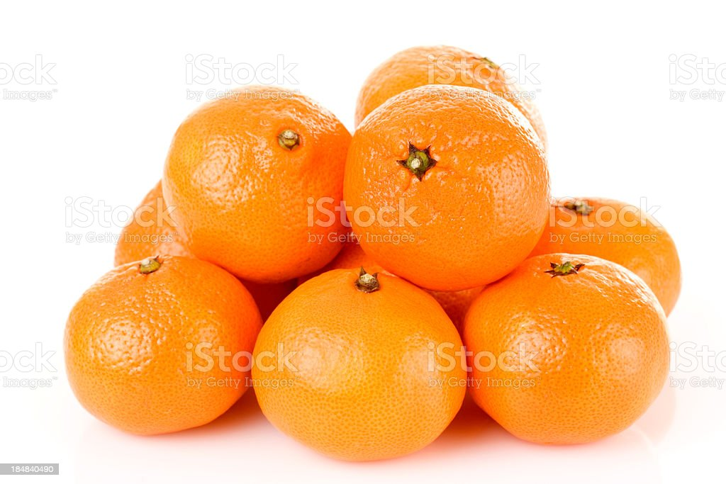 Pile of bright fresh tangerine fruits on a white background stock photo
