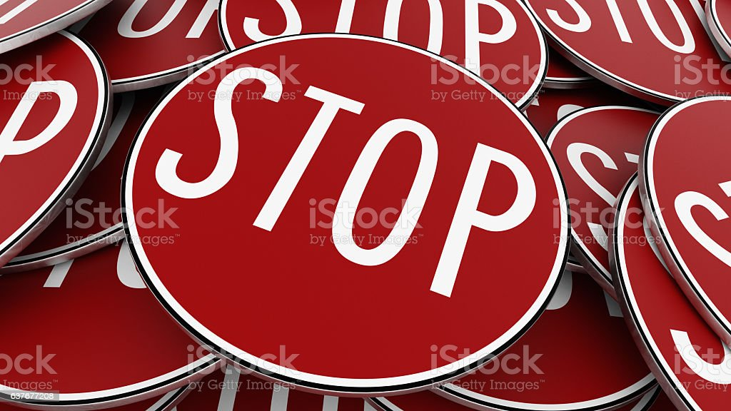 Pile of Bright Red Circular Stop Signs Close Up stock photo