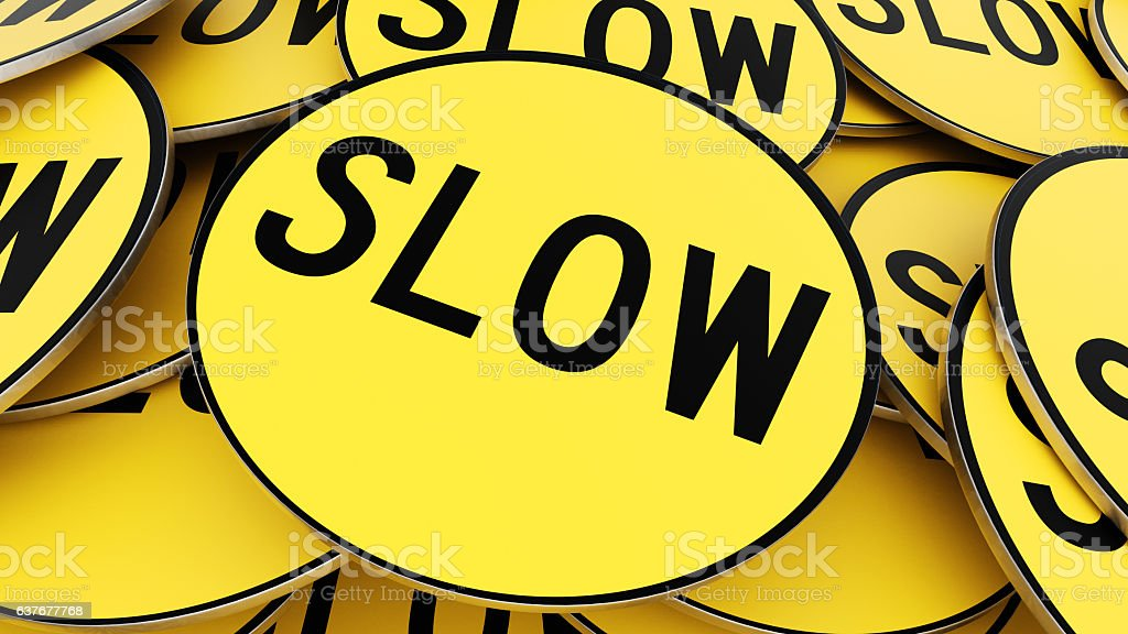 Pile of Bright Yellow Circular Slow Sign, Close Up stock photo