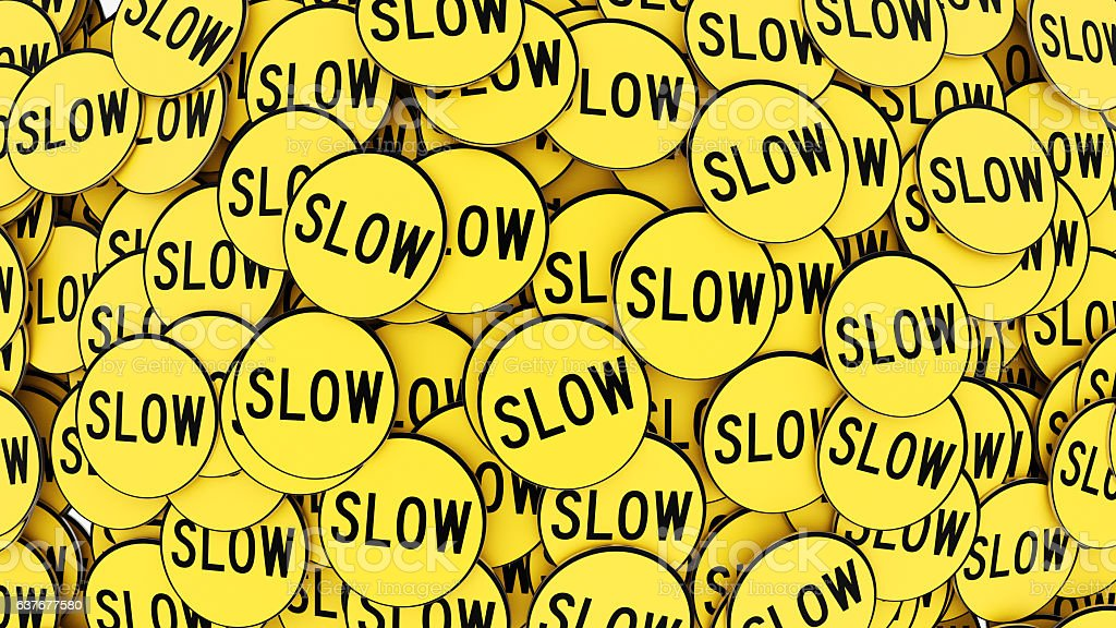 Pile of Bright Yellow Circular Slow Sign, Wide Angle Shot stock photo