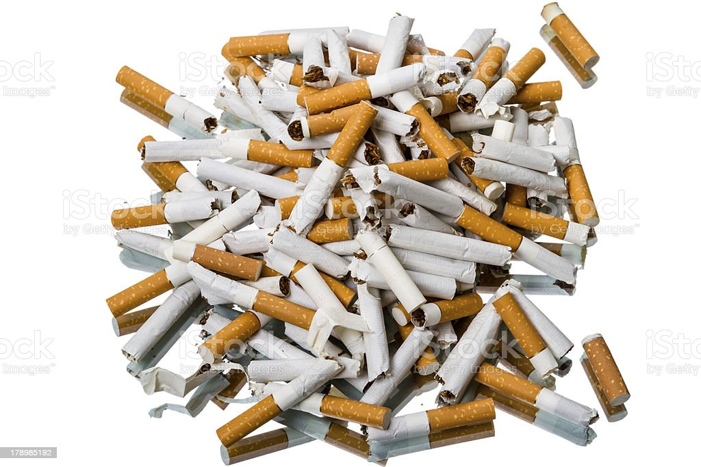 Pile of broken cigarettes top view royalty-free stock photo