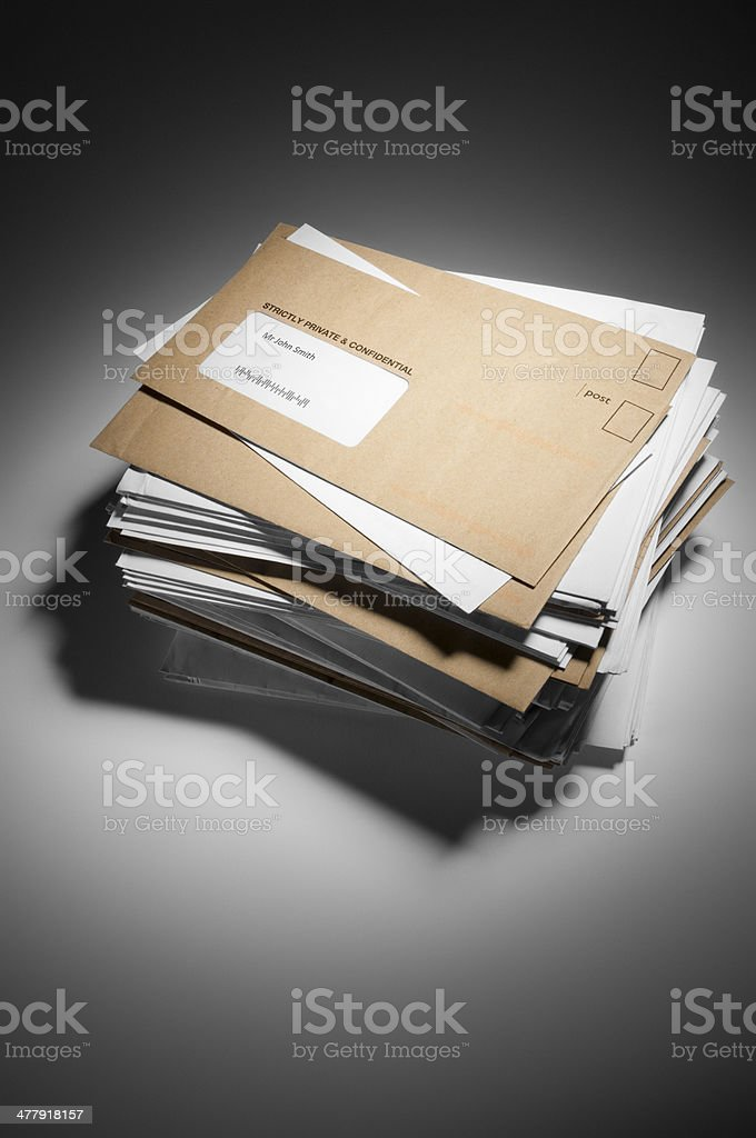 Pile of brown and white envelopes received in post stock photo