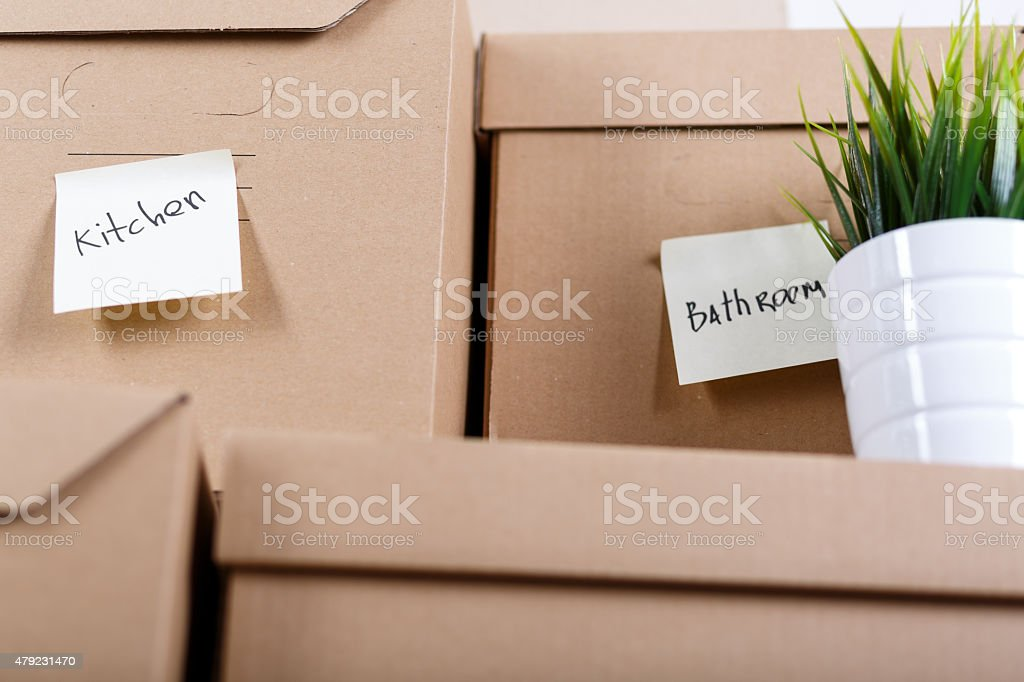 Pile of brown cardboard boxes with house or office goods. stock photo