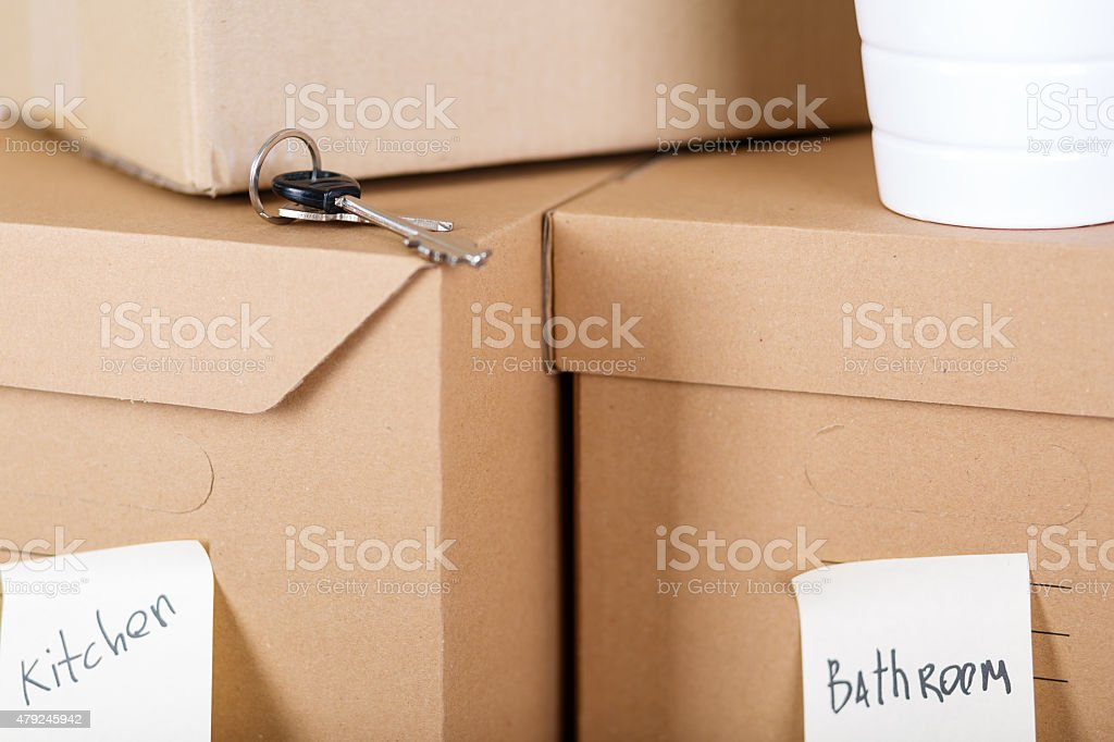 Pile of brown cardboard boxes with house or office goods stock photo