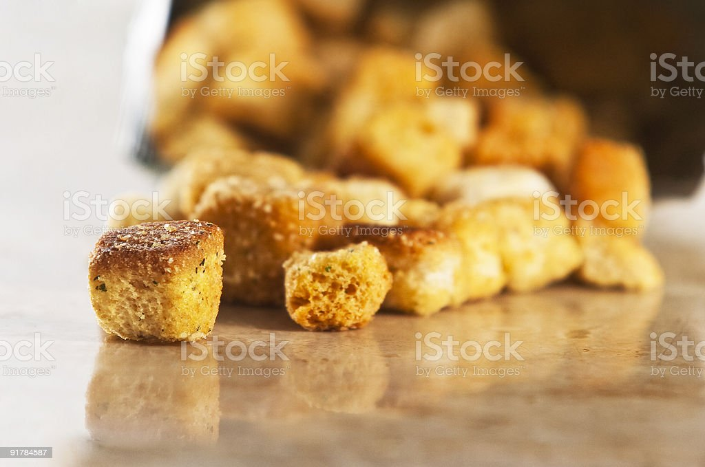 A pile of brown croutons on a reflective surface stock photo