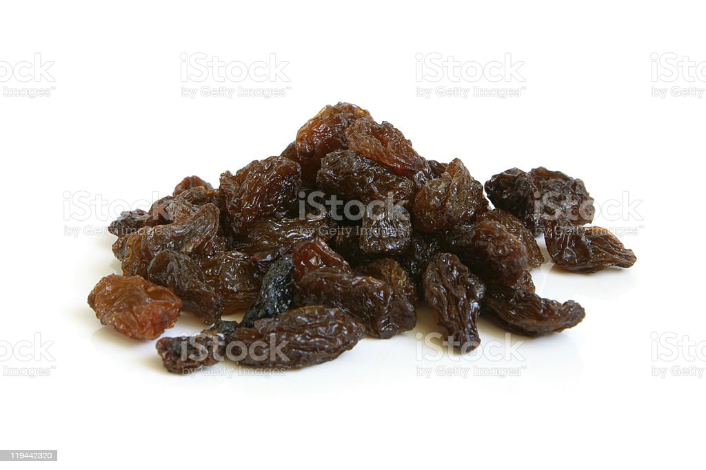 A pile of brown raisins on a white background stock photo