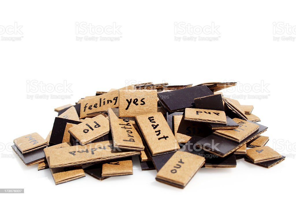 A pile of brown tiles with various words written on them royalty-free stock photo